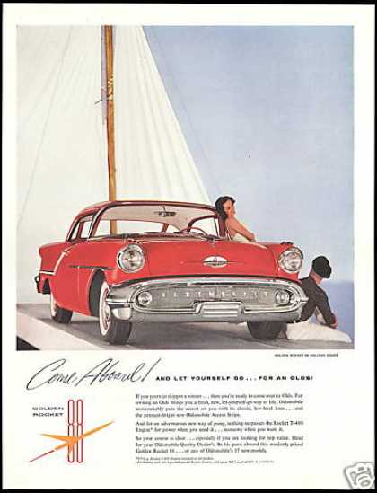 Red Oldsmobile 88 Holiday Coupe Car Sailboat (1957)