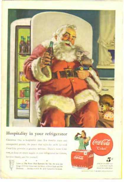Coke Christmas &#8211; Santa sitting by fridge (1947)