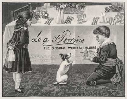 Two Children Tempt a Small Dog with a Spoon of Lea and Perrins Original Worcestershire Sauce