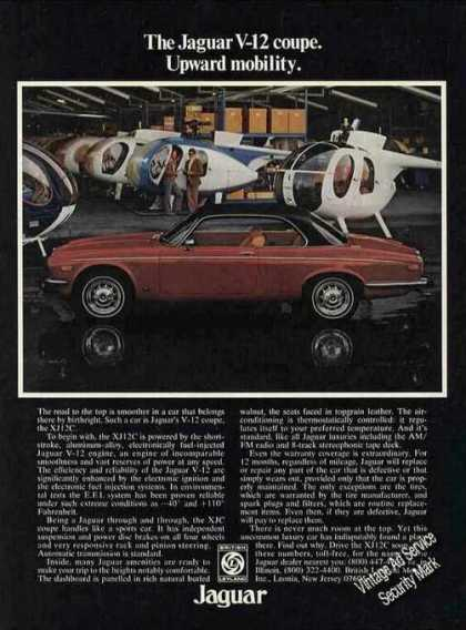 Jaguar V-12 Coupe Helicopters In Background Car (1976)